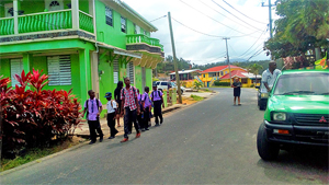 School children walking through the village