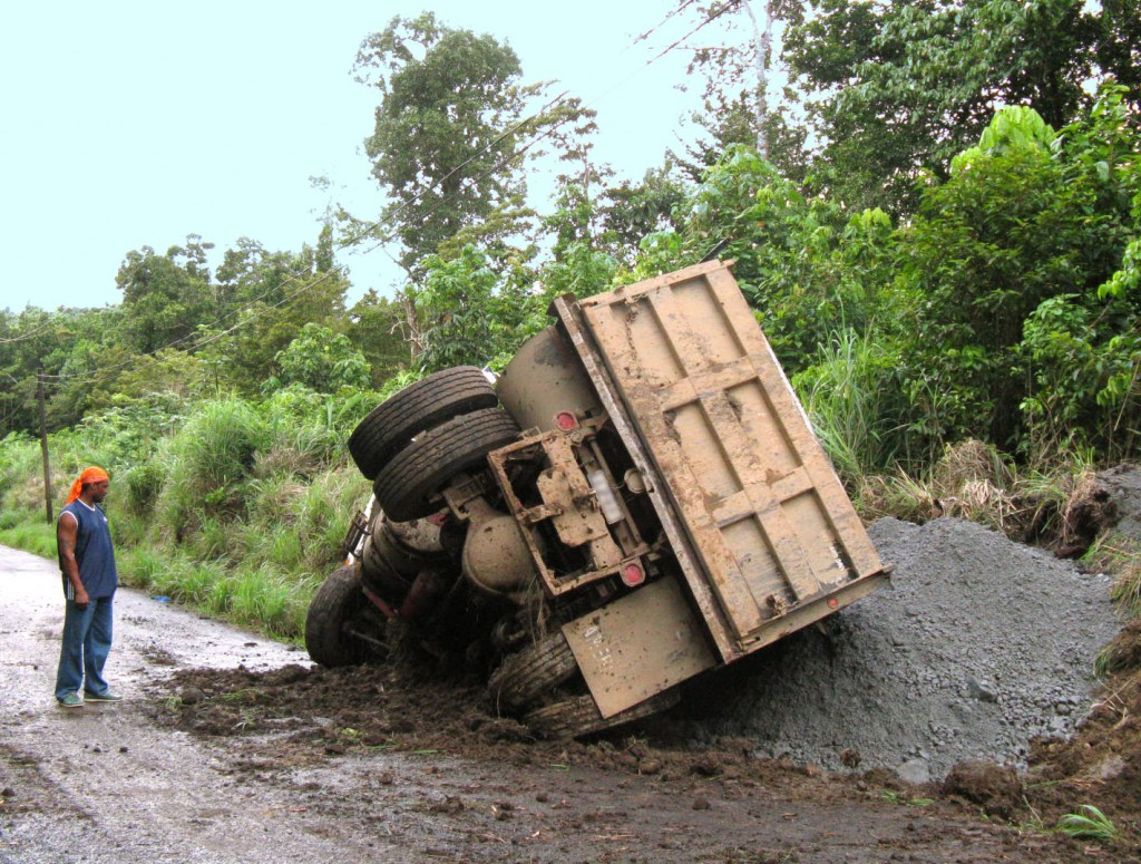 Truck slides off the road in Dominica.